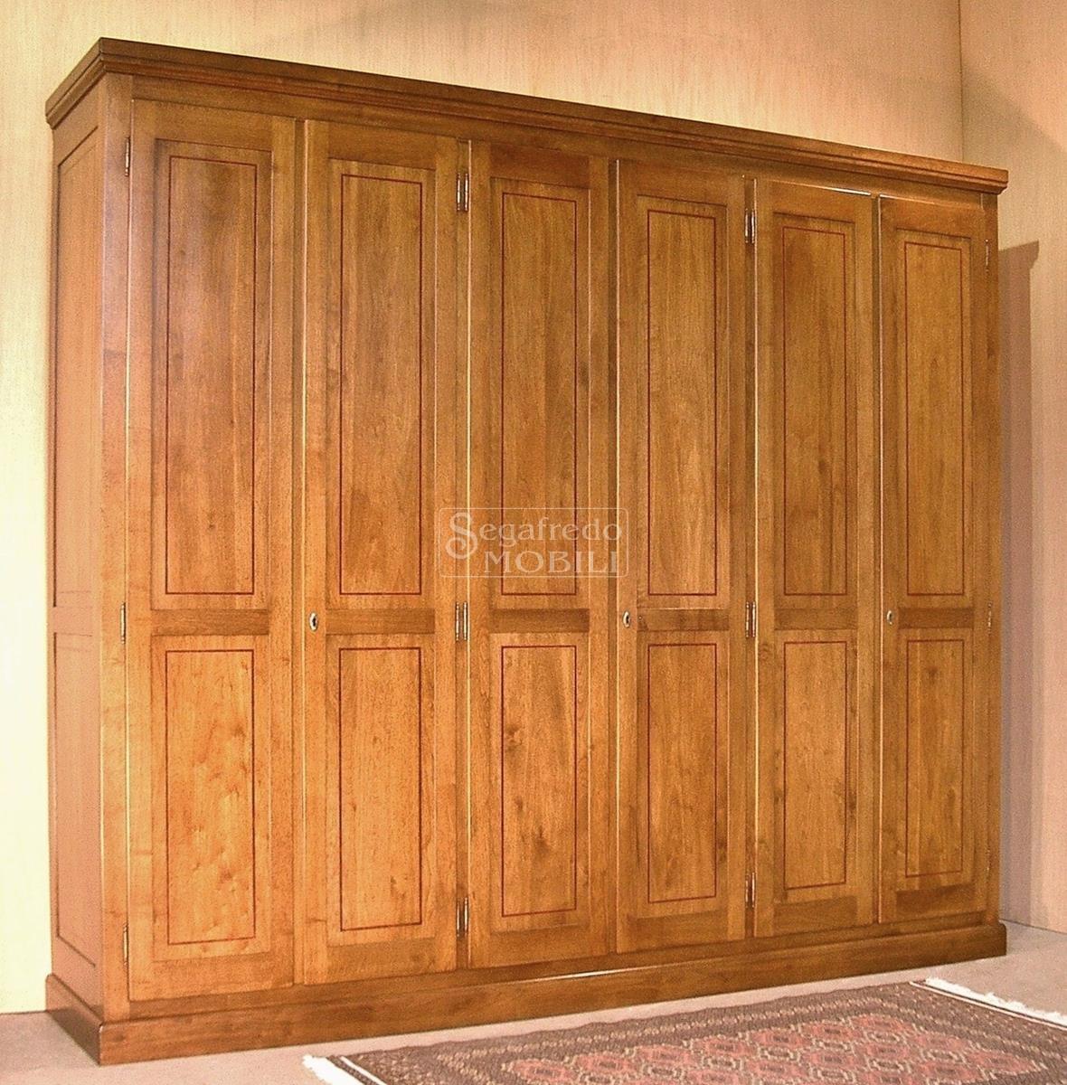 pannelli in legno intarsiato : Armadio in legno massello a 6 ante battenti con filetto intarsiato ...